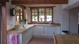 Shaker Wood white Kitchen with laminate worktops